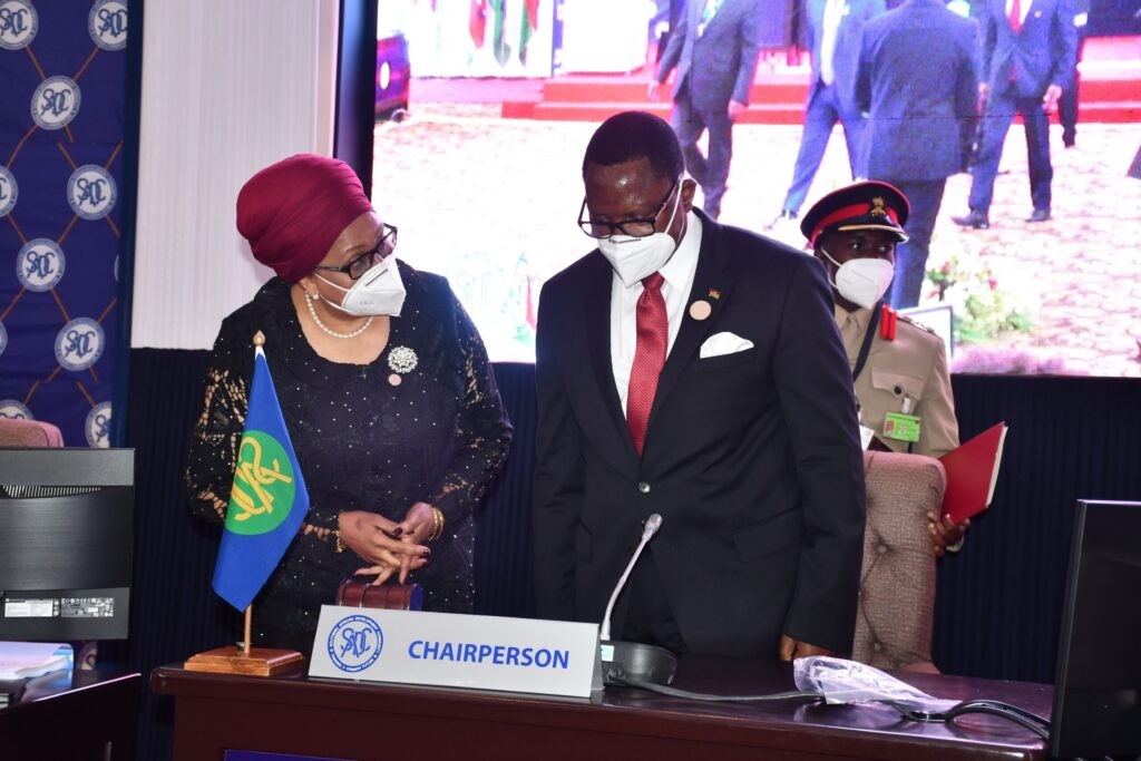 SADC Executive Secretary Dr Stergomena Lawrence Tax interacts with SADC Chairperson President Dr Lazarus Chakwera during the summit pic by Lisa Kadango 3 scaled